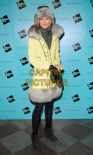TRINNY WOODALL .At the Somerset House Ice Rink VIP Opening, Somerset House, The Strand, London, England, UK, .November 22nd 2010..full length yellow fur grey gray trim trimmed coat hat black tights ankle boots wedges gloves deer stalker .CAP/CAN.©Can Nguyen/Capital Pictures.