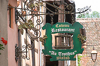 wrought iron sign au trotthus riquewihr alsace france