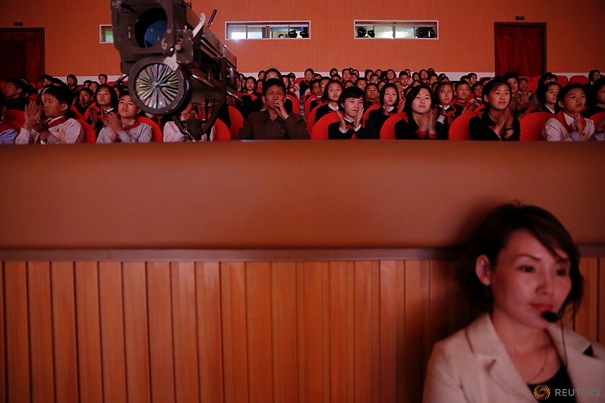 A member of staff and spectators follow a performance at the Mangyongdae Children's Palace in Pyongyang, North Korea May 5, 2016.  REUTERS/Damir Sagolj