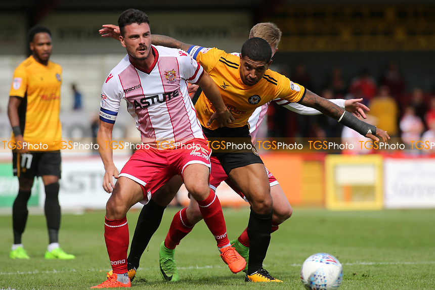 Ronnie Henry of Stevenage and Newport's Joss Labadie challenge for the ball during Stevenage vs Newport County, Sky Bet EFL League 2 Football at the Lamex Stadium on 5th August 2017