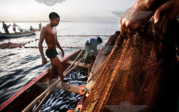 Fishermen haul in their nets, fishing off the coast of Tarrafal on the Northern part of Santiago Island..