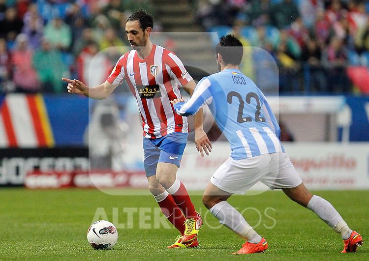 Atletico de Madrid's Juanfran Torres and Malaga's Francisco Alarcon Isco (r) during La Liga match. Mayo 5,2012. (ALTERPHOTOS/Arnedo & Alconada)