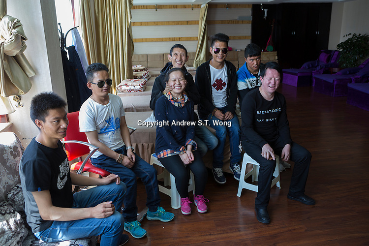 Blind Tibetan headmaster Nyima Wangdu (Centre) of the School for the Blind in Tibet meets his graduated students who are professional masseurs at the Hukang Blind Massage Clinic in the capital city of Lhasa, September 2016.