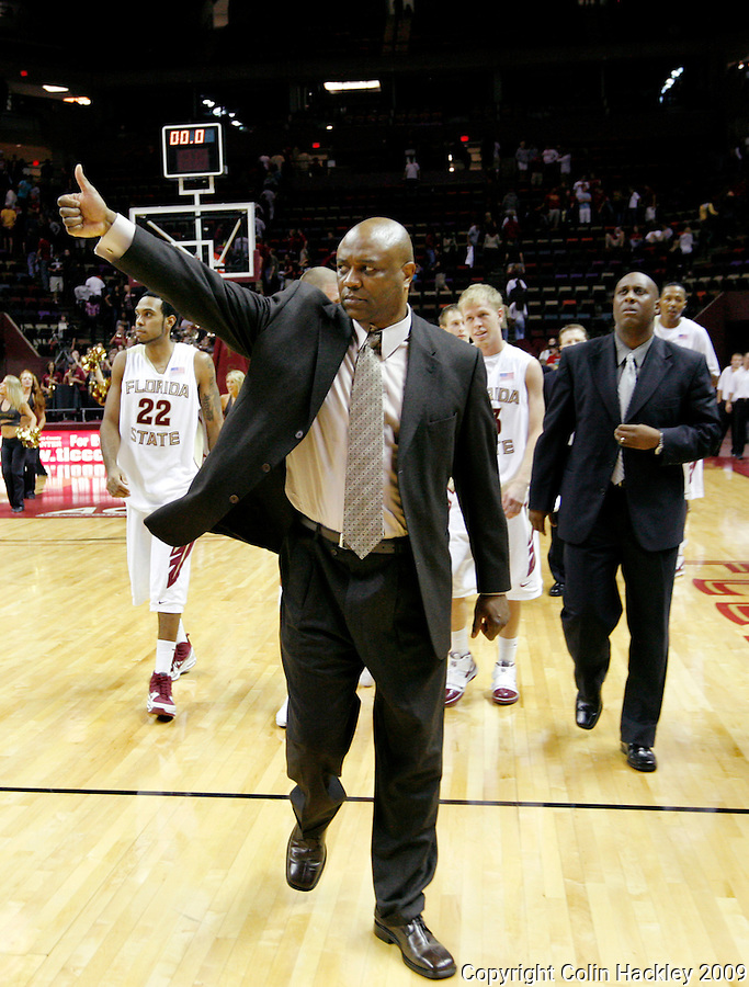 TALLAHASSEE, FL 11/16/09-FSU-JU BB09 CH36-Florida State Head Coach Leonard Hamilton, center, reacts to the crowd after the Jacksonville University game, Monday at the Donald L. Tucker Center in Tallahassee. The Seminoles beat the Dolphins 87-61...COLIN HACKLEY PHOTO