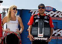 Sept. 1, 2013; Clermont, IN, USA: NHRA funny car driver Cruz Pedregon (right) and Courtney Force during qualifying for the US Nationals at Lucas Oil Raceway. Mandatory Credit: Mark J. Rebilas-