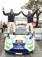 03-05-2015: Kevin Flanagan, left, and  Donagh Kelly, driver, overall winners,  celebrate at the finish of the  the 36th  cartell.ie International Rally of the Lakes 2015 at  The Gleneagle Hotel, Killarney on Sunday . Picture: Eamonn Keogh (macmonagle.com)