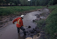 Cleanup of a creek full of sludge is all that is visibly left after what is been called the worst environmental disaster in the eastern United States occurred in Inez Kentucky in Oct 2000 when after heavy rains a dam failed after heavy rain and 300 million gallons of toxic sludge broke through underground mine and shot out of the side of a mountain like a lava flow surrounding houses and poisoning two streams and drinking water for 17 communities.