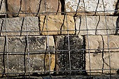 Large stones in metal frameworks at the new Scottish Parliament building at Holyrood, Edinburgh.  Designed by Spanish architect, Enric Miralles.