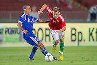 Israel's Avihay Yadin (L) and Hungary's Vladimir Koman (R) fight for the ball during a friendly football match Hungary playing against Israel in Budapest, Hungary on August 15, 2012. ATTILA VOLGYI