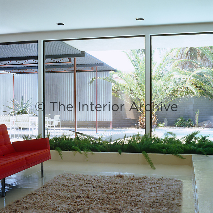 The generous floor-to-ceiling glass walls blur the lines between indoors and outdoors