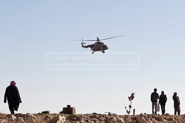 11/12/2014. Sinjar Mountains, Iraq. An Iraqi Air Force Mi-171E Hip helicopter comes in for a supply run on the top of Mount Sinjar.<br /> <br /> Although a well publicised exodus of Yazidi refugees took place from Mount Sinjar in August 2014 many still remain on top of the 75 km long ridge-line, with estimates varying from 2000-8000 people, after a corridor kept open by Syrian-Kurdish YPG fighters collapsed during an Islamic State offensive. The mountain is now surrounded on all sides with winter closing in, the only chance of escape or supply being by Iraqi Air Force helicopters.