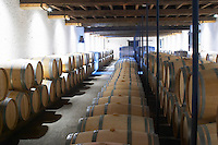barrel aging cellar chateau le boscq st estephe medoc bordeaux france