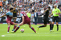 Declan Rice of West Ham United tackles Raheem Sterling of Manchester City during West Ham United vs Manchester City, Premier League Football at The London Stadium on 10th August 2019