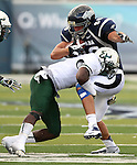 South Florida defender Kayvon Webster (6) tackles Nevada's Chance Early (88) during the second half of an NCAA college football game Saturday, Sept. 8, 2012, in Reno, Nev. South Florida won 32-31. (AP Photo/Cathleen Allison)