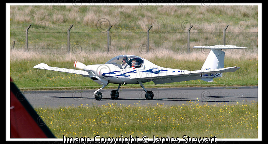 12/06/2006        Copyright Pic: James Stewart.File Name : sct_jspa02_cumbernauld_plane.STOCK PIC OF AIRCRAFT NO. G-BWLB OR G-BWLP    AT CUMBERNAULD AIRPORT...Payments to :.James Stewart Photo Agency 19 Carronlea Drive, Falkirk. FK2 8DN      Vat Reg No. 607 6932 25.Office     : +44 (0)1324 570906     .Mobile   : +44 (0)7721 416997.Fax         : +44 (0)1324 570906.E-mail  :  jim@jspa.co.uk.If you require further information then contact Jim Stewart on any of the numbers above.........