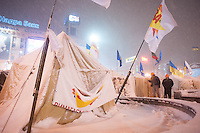 Tents pitched by the protesters on Independence Square under a heavy snowfall. The city prepares for a forced evacuation tonight. The police authorities are planning to forcedly evacuate the streets from the protesters blocking all the government buildings. Kiev. Ukraine