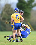 Colin Guilfoyle of  Newmarket hits the turf under pressure from  Sixmilebridge's Jamie Shanahan and Caimin Morey during their Clare Champion Cup final at Clonlara. Photograph by John Kelly.