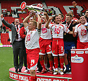 Mark Roberts of Stevenage lifts the trophy after winning the npower League 2 play-off final between Stevenage and Torquay United at Old Trafford, Manchester on 28th May, 2011.© Kevin Coleman 2011.