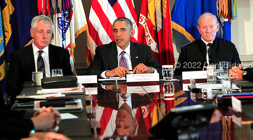 United States President Barack Obama meets with Senior Military Leadership at the Pentagon in Washington, D.C. on October 6, 2014. From left to right: U.S. Secretary of Defense Chuck Hagel, President Obama, and Chairman of the Joint Chiefs of Staff General Martin Dempsey, U.S. Army. <br /> Credit: Dennis Brack / Pool via CNP