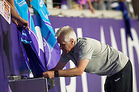 Orlando, Florida - Saturday, April 23, 2016: Orlando Pride head coach Tom Sermanni signs an autograph for a fan after an NWSL match between Orlando Pride and Houston Dash at the Orlando Citrus Bowl.  Orlando Pride defeated Houston Dash 3.1.