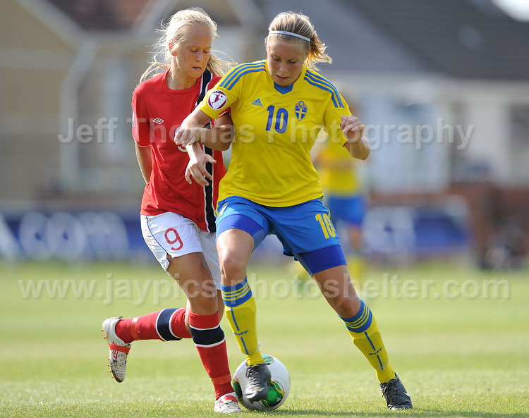 Amalie Vevie Eikeland of Norway battles with Fanny Andersson of Sweden during the UEFA Womens U19 Championships at Stebonheath park Sunday 25th August 2013. All images are the copyright of Jeff Thomas Photography-www.jaypics.photoshelter.com-07837 386244-Any use of images must be authorised by the copyright owner.