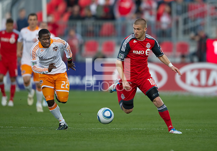 07 May 2011: Houston Dynamo midfielder Lovel Palmer #22 and Toronto FC forward Alen Stevanovic #10 in action during an MLS game between the Houston Dynamo and the Toronto FC at BMO Field in Toronto, Ontario..Toronto FC won 2-1.