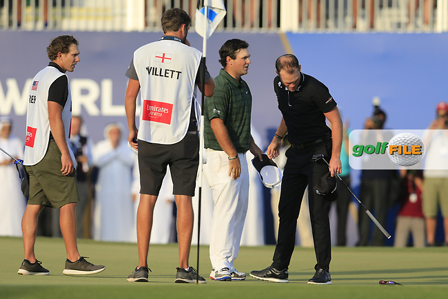 Patrick Reed (USA) congratulates Danny Willett (ENG) on his way to winning the DP World Tour Championship, Jumeirah Golf Estates, Dubai, United Arab Emirates. 18/11/2018<br /> Picture: Golffile | Fran Caffrey<br /> <br /> <br /> All photo usage must carry mandatory copyright credit (&copy; Golffile | Fran Caffrey)