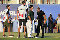 Patrick Reed (USA) congratulates Danny Willett (ENG) on his way to winning the DP World Tour Championship, Jumeirah Golf Estates, Dubai, United Arab Emirates. 18/11/2018<br /> Picture: Golffile | Fran Caffrey<br /> <br /> <br /> All photo usage must carry mandatory copyright credit (© Golffile | Fran Caffrey)