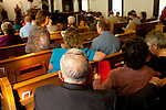 Residents from Cheshire, and the surrounding area, attend the Sunday morning service at Cheshire Baptist Church...Coal-fired smokestacks can be seen from just about anywhere in Cheshire, Ohio. The village, which is along the Ohio River, has a population that is a fraction of what it was just years before. The schools sit empty with locked doors. In 2002, the American Electric Power Company settled with citizens over an investigation in pollution and the consequences it had on the residents. The power plant had a $20 million buyout and most of the more than 200 residents sold their property and left. Still, some residents remain in Cheshire today.