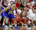 SIOUX FALLS, SD: MARCH 6: Trey Dickerson #0 of South Dakota drives on Michael Orris #50 of South Dakota State during the Summit League Basketball Championship on March 6, 2017 at the Denny Sanford Premier Center in Sioux Falls, SD. (Photo by Dick Carlson/Inertia)
