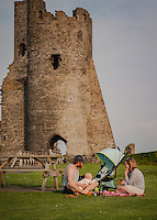 UK Weather: Aberystwyth, Ceredigion, West Wales <br />A young family have a picnic by Aberystwyth Castle during the early evening.