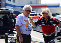 Sept. 15, 2012; Concord, NC, USA: NHRA top fuel dragster driver Chris Karamesines (left) with his wife during qualifying for the O'Reilly Auto Parts Nationals at zMax Dragway. Mandatory Credit: Mark J. Rebilas-