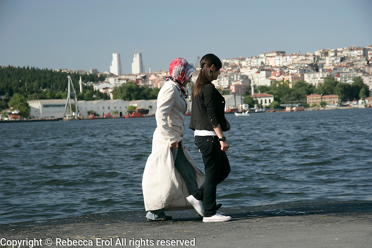 Turkish girls walking by the Golden Horn, Istanbul, Turkey