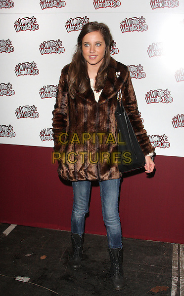 MADELINE DUGGAN .Winter Wonderland VIP Preview at Hyde Park, London , England, UK, .November 18th 2010..full length brown faux fake fur coat jeans boots .CAP/ROS.©Steve Ross/Capital Pictures