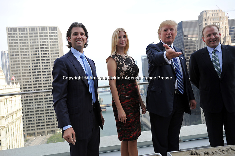 (L-r) Donald Trump Jr., Ivanka Trump, Donald Trump, and Chicago Alderman Brendan Reilly appear at the topping-off ceremony of the new 92-story tall Trump International Hotel and Tower building in Chicago, Illinois on September 24, 2008.  The building will be the tallest in North America upon its completion in six months.