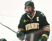 Mike Paliotta (UVM - 2) - The visiting University of Vermont Catamounts defeated the Northeastern University Huskies 6-2 on Saturday, October 11, 2014, at Matthews Arena in Boston, Massachusetts.