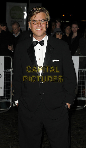 AARON SORKIN.London Critics' Circle Film Awards at BFI Southbank, London, England..February 10th 2011.ALFS half length black white bow tie tuxedo glasses hands in pockets .CAP/CAN.©Can Nguyen/Capital Pictures.