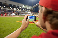 A member of the Eastern All-Stars takes a video of Travis Witherspoon (2) of the Cedar Rapids Kernels during the Midwest League All-Star Home Run Derby at Modern Woodmen Park on June 20, 2011 in Davenport, Iowa. (David Welker / Four Seam Images)