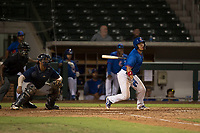 AZL Cubs catcher Henderson Perez (8), lines a ball to right field in front of home plate umpire Demetrius Hicks and AZL Brewers catcher Caleb Marquez (57),during an Arizona League game against the AZL Brewers at Sloan Park on June 29, 2018 in Mesa, Arizona. The AZL Cubs 1 defeated the AZL Brewers 7-1. (Zachary Lucy/Four Seam Images)