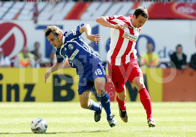 Fussball   1. Bundesliga   Saison 2006/2007   29. Spieltag FSV Mainz 05 - FC Schalke 04                  RAFINHA (li, Schalke) gegen Markus FEULNER (re, Mainz)