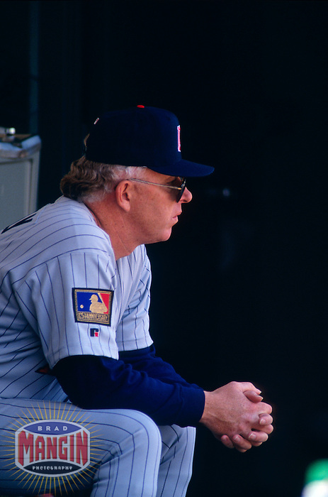OAKLAND, CA - Manager Tom Kelly of the Minnesota Twins sits in the dugout during a game against the Oakland Athletics at the Oakland Coliseum in Oakland, California in 1994. Photo by Brad Mangin