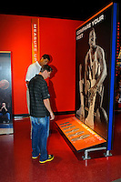 30 September, 2010, Kansas City, Kansas USA.The College Basketball Experience.Brad Daugherty and Denny Hamlin check the size of their feet against some basketball greats..©2010, F. Peirce Williams, USA.