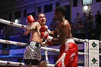 Rakeem Noble (red shorts) defeats Georgie Wright during a Boxing Show at York Hall on 10th June 2017