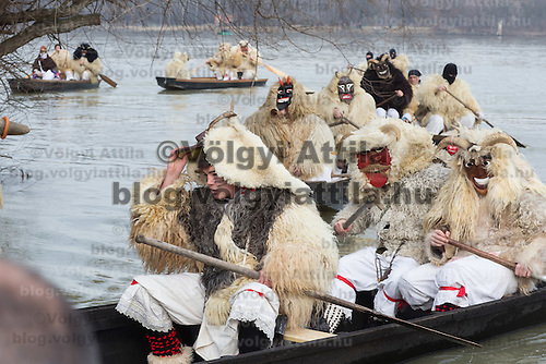 Local people in traditional buso dresses cross river Danube as they celebrate the Buso Carnival in Mohacs (about 200 km South from capital city Budapest), Hungary on February 07, 2016. ATTILA VOLGYI