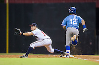 Ramon Osuna (19) of the Danville Braves stretches for a throw as Gabriel Cancel (12) of the Burlington Royals runs towards first base at American Legion Post 325 Field on August 16, 2016 in Danville, Virginia.  The game was suspended due to a power outage with the Royals leading the Braves 4-1.  (Brian Westerholt/Four Seam Images)