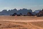 Desert sand and mountains in the Wadi Rum Protected Area, a UNESCO World Heritage Site.  Um Sahn sandstone.  Hashemite Kingdom of Jordan.