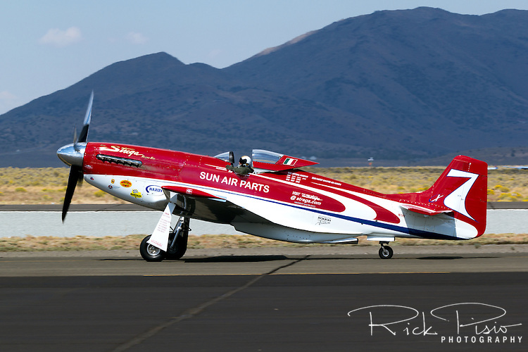 "Pilot Matt Jackson taxies the P-51 Mustang ""Strega"" on the ramp at Stead Field during the 2013 National Championship Air Races."