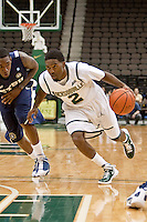 January 14, 2012:    Jacksonville Dolphins guard Russell Powell (2) dribbles the ball during Atlantic Sun conference action between the Jacksonville University Dolphins and East Tennessee State University Buccaneers at Veterans Memorial Arena in Jacksonville, Florida.   East Tennessee State defeated Jacksonville 72-58.
