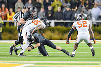 Baylor quarterback Bryce Petty (14) is brought down by Oklahoma State defensive end Vili Leveni (95) during first half of an NCAA football game, Saturday, November 22, 2014 in Waco, Tex. Baylor leads 28-14 at the halftime. (Mo Khursheed/TFV Media via AP Images)