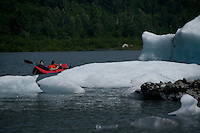 Kayakers paddle among the icebergs on Spencer Lake.